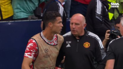 Manchester United's Cristiano Ronaldo checks on a steward's health after misfiring a shot in warmups
