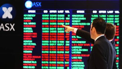 Banks help ASX close higher after rate cut