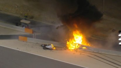F1 driver Romain Grosjean escaped with minor burns after his car split in half and exploded into flames at the Bahrain GP.