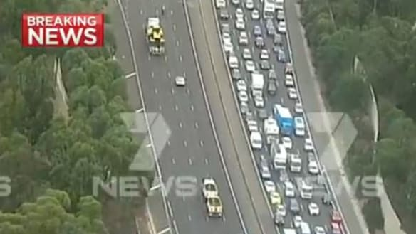 Truck hits motorcycle: Man critical after serious crash on the Eastern Fwy