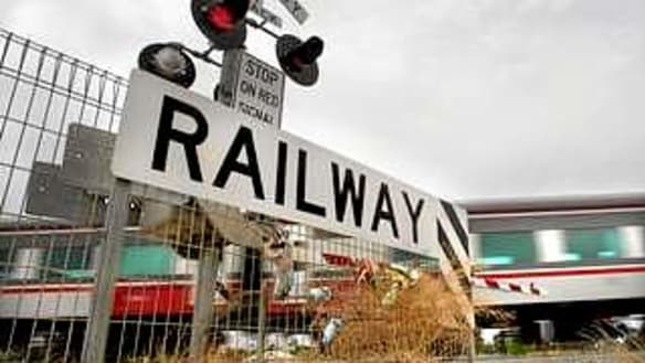25 more rail level crossings to go under Labor pledge