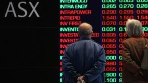 ASX backtracks from fresh decade high as banks slide