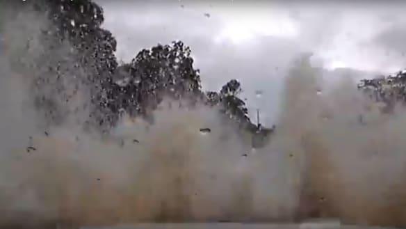 'I've crashed into a river, dude': Dash cam shows Sydney driver skidding into flood