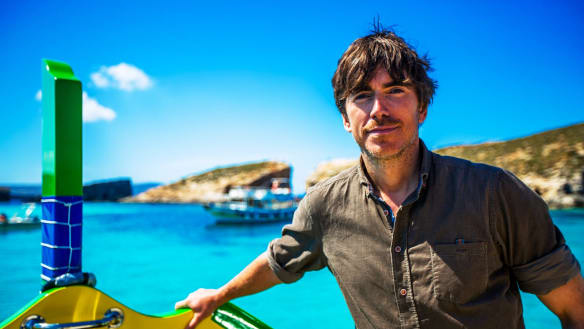 TV presenter Simon Reeve on Malta's Blue Lagoon.