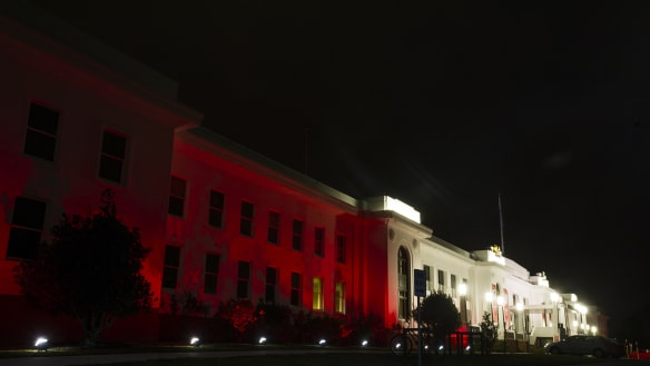 Canberra monuments light up in red for cystic fibrosis awareness