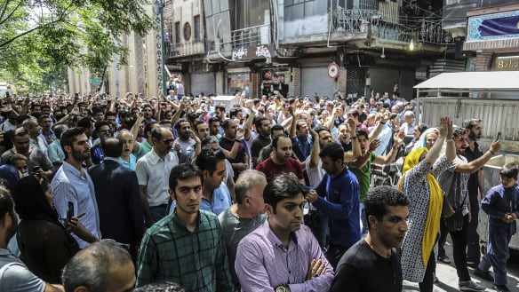 Iranian economic protesters take to streets, confront police
