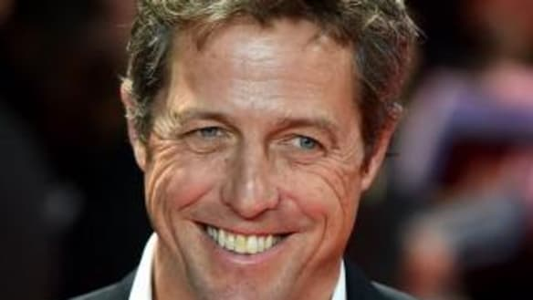 Hugh Grant marries for first time at 57