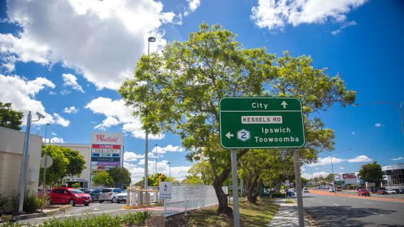 Sinkhole opens on road outside Brisbane shopping centre