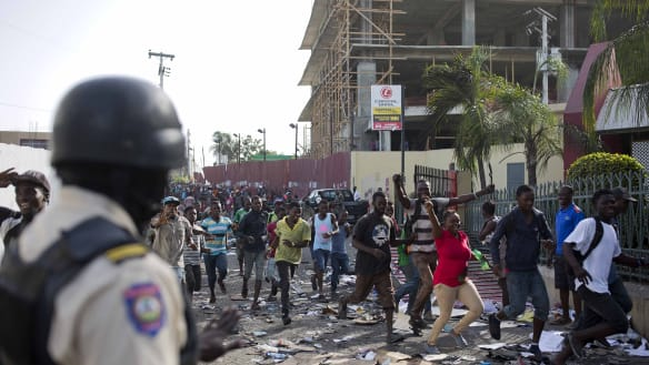 Deaths, looting follows protests in Haitian capital