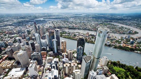 Cab lands on roof after inner-Brisbane accident