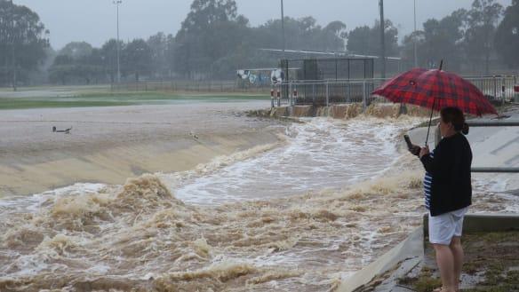 Canberra hit by flash flooding as storm brings lots of rain