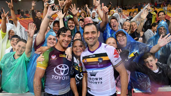 Rain men: Johnathan Thurston and Cameron Smith.