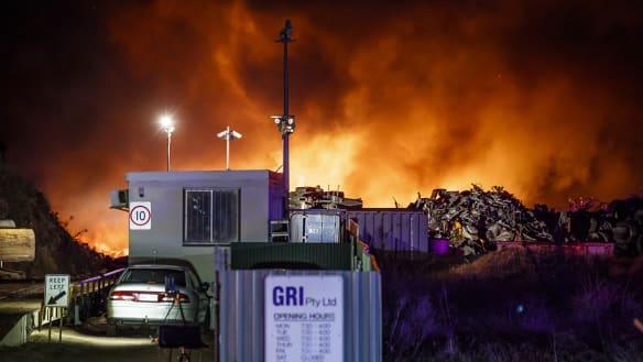 'A big explosion': Firefighters bring scrapyard blaze under control