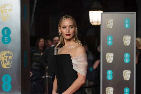 Jennifer Lawrence poses for photographers upon arrival at the BAFTA Film Awards, in London, Sunday, Feb. 18, 2018.