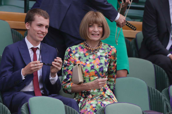 Anna Wintour takes her seat in the Royal Box on Centre Court ahead of the men's singles semifinal match between John Isner of the United States and South Africa's Kevin Anderson at the Wimbledon Tennis Championships.