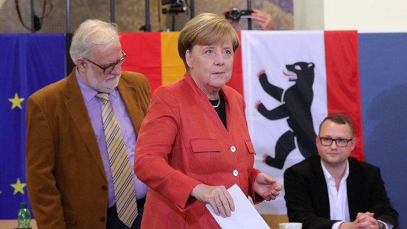 Angela Merkel, Germany's Chancellor and Christian Democratic Union (CDU) leader, casts her vote.