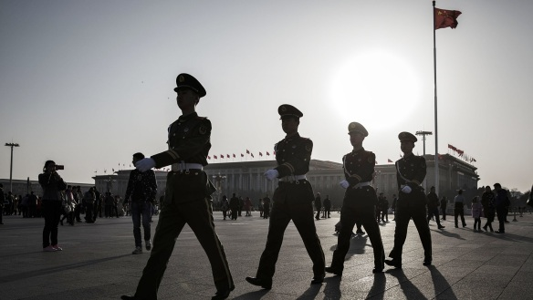 Members of the Chinese People's Armed Police march through Tiananmen Square in Beijing, China