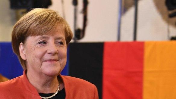 German Chancellor Angela Merkel smiles as she casts her vote in Berlin.