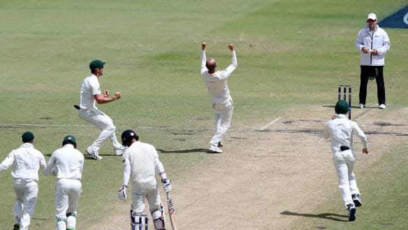 Nathan Lyon and the Australians celebrate the wicket of Moeen Ali on day five.