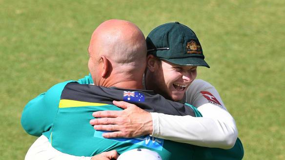 Australian captain Steve Smith shares a moment with coach Darren Lehmann after their team's big win on Monday.
