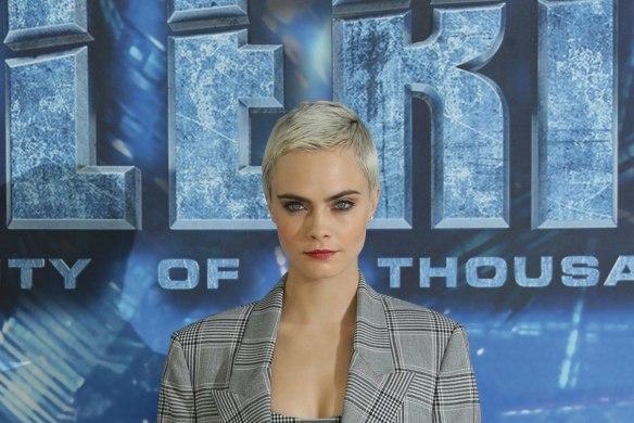 Cara Delevingne works the over-sized, plaid blazer trend.