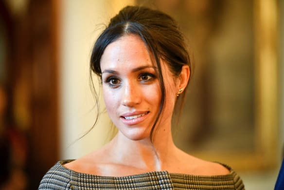 Meghan Markle speaks to people in the Drawing Room of Cardiff Castle in Cardiff, Wales, Thursday, Jan. 18, 2018. During their tour, Prince Harry and Ms. Markle will hear performances from musicians and poets, meet sportsmen and women, and see how organisations are working to promote Welsh language and cultural identity. (Ben Birchall/Pool Photo via AP)