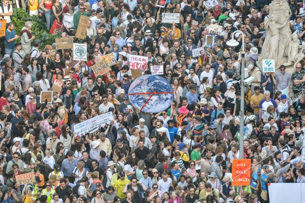 More than 100,000 protesters descend on city to demand climate action