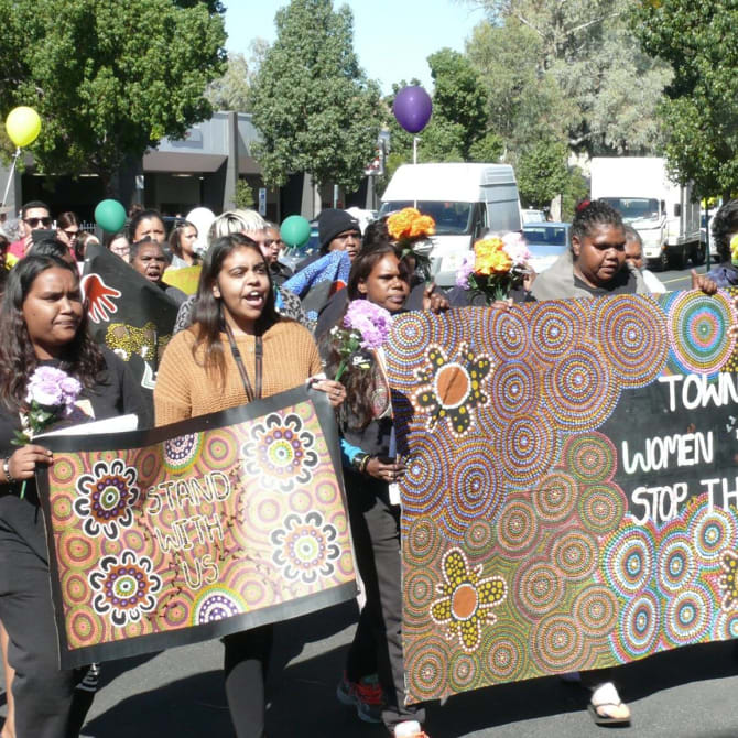 Women in the Tangentyere group march in Alice Springs.