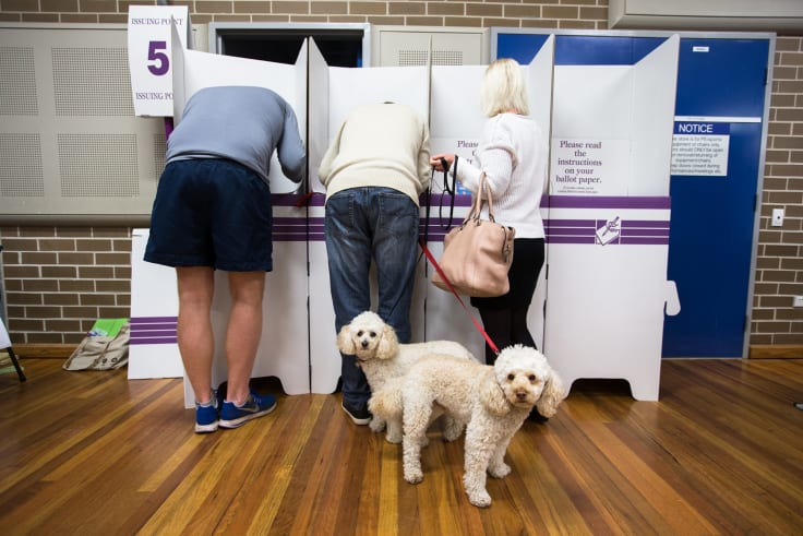 Low on trust: people vote during the 2016 Australian federal election.