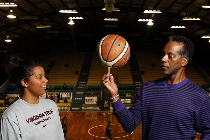 Hannah Young with her father Lewis Young, a former professional basketball player and Harlem Globetrotter, in 2012.