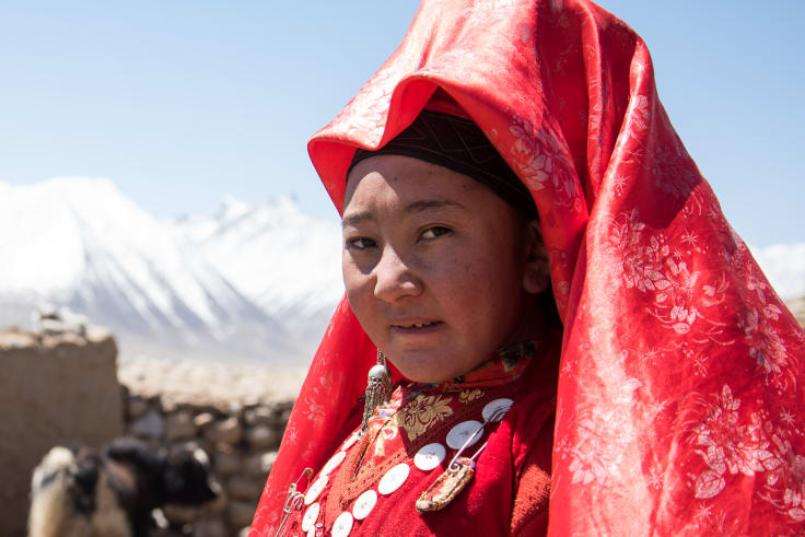 Young, unmarried girls wear bright red veils in the Wakhan corridor.