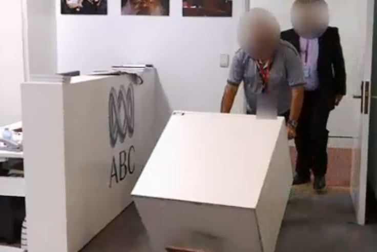 ASIO staff deliver a safe to the ABC's Parliament House bureau on February 1.
