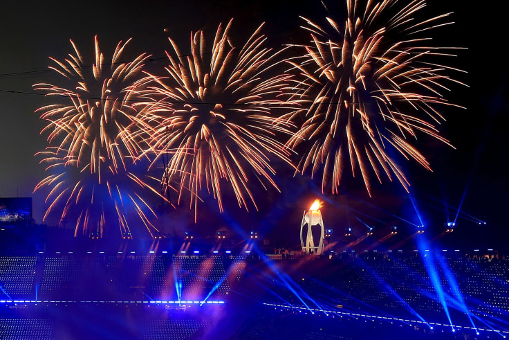 Fireworks go off after the Olympic flame was lit during the opening ceremony of the 2018 Winter Olympics in Pyeongchang, South Korea,.
