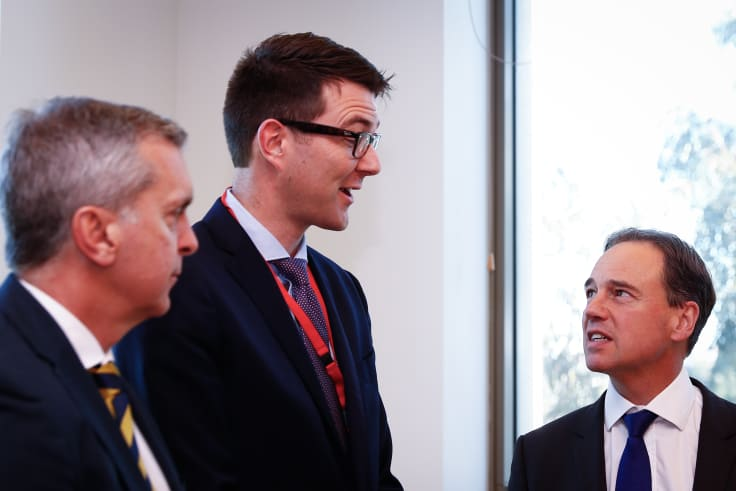 Dr Bastian Seidel (centre), pictured here with Health Minister Greg Hunt (right) in May 2017.