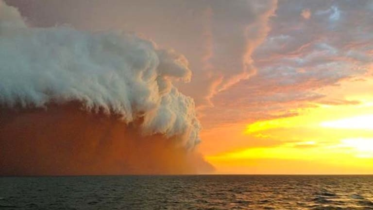 A wall of dust and water whipped up by cyclone Narelle as seen in this photo. taken by Brett Martin 25 nautical miles north-west of Onslow, Western Australia.