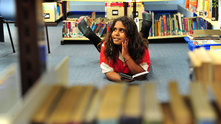 Yulcaila Hoolihan-Mongta, 11, of Forrest Primary School in Canberra, participates in the Indigenous Reading Project, using a Kindle to boost her reading skills.