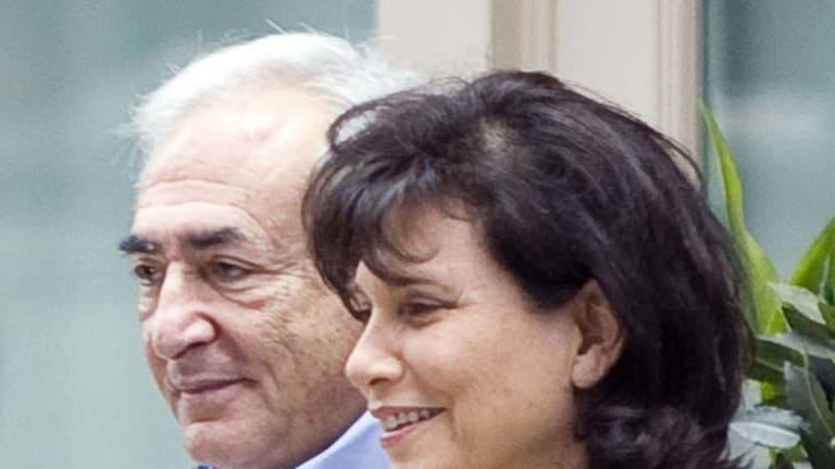 Liberty ... Dominique Strauss-Kahn with his wife in New York.