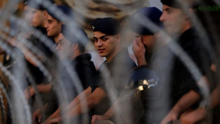 Conflict spreads: Lebanese police guard the area surrounding the Parliament in Beirut.