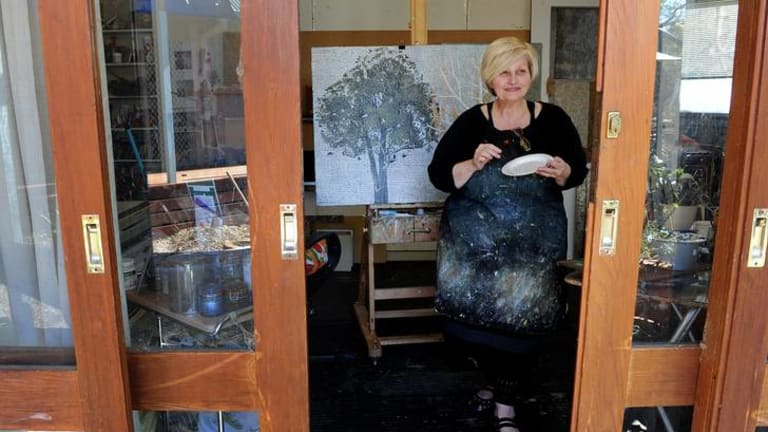 Artist Dianne Fogwell who is a finalist in the prestigeous Portia Geach art prize works in her art studio.