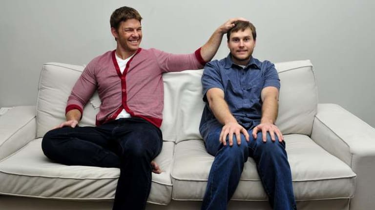 Brumbies player Clyde Rathbone with his comedian brother Dayne who will be performing in Canberra.