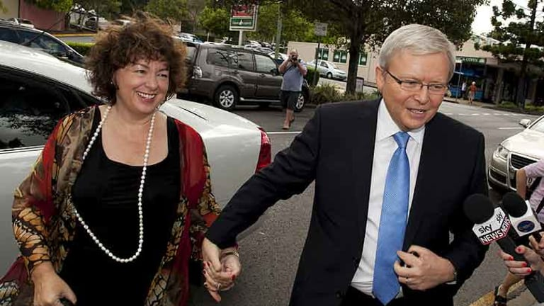 Therse Rein and Kevin Rudd enter their local Church in the Brisbane suburb of Bulimba on February 26, 2012.