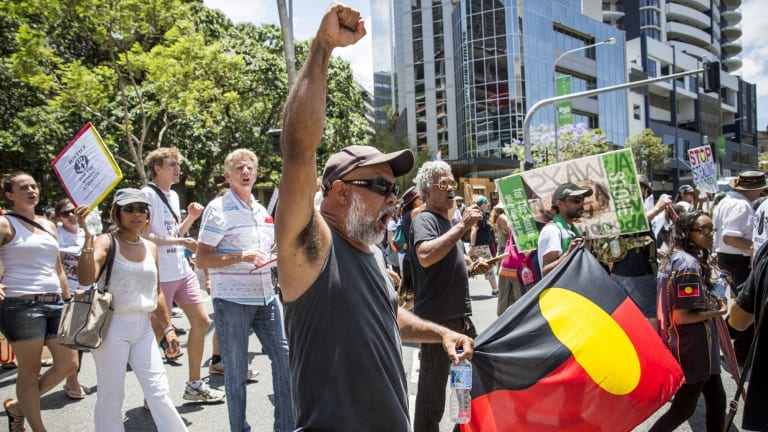 Demonstrators protest in the Brisbane CBD.