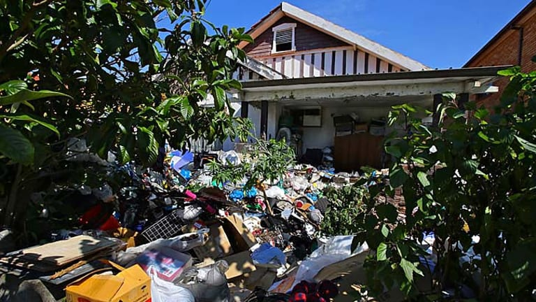 Rubbish litters the yard of the Bondi home.