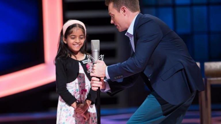 Grant Denyer prepares Harpita for her turn on Channel Ten's <i>The Great Australian Spelling Bee</i>.