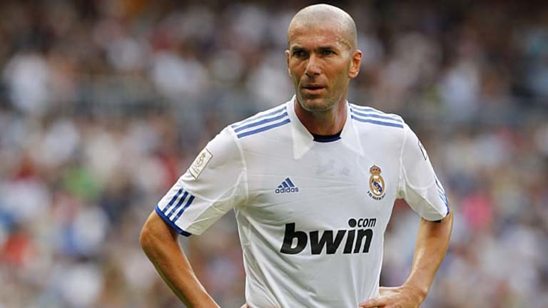 Tummies in: Real Madrid's sports director Zinedine Zidane has been giving weight loss tips to Karim Benzema.
