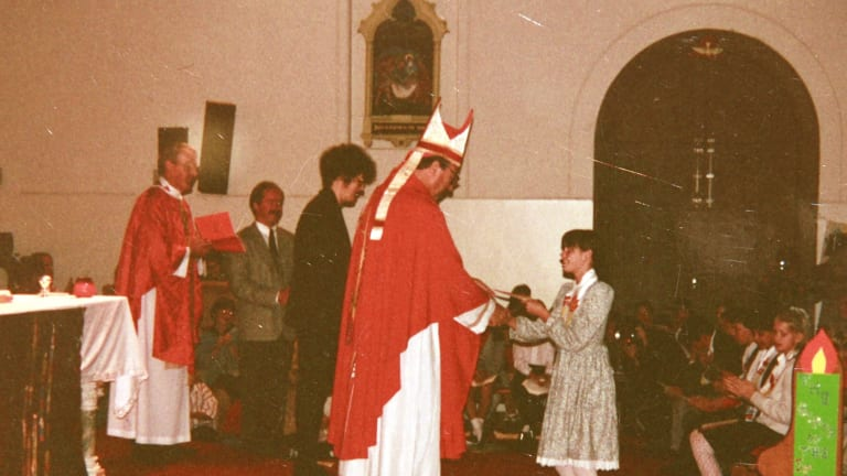 Emma Foster receiving her confirmation certificate from then Bishop George Pell at Sacred Heart Church in Oakleigh, Melbourne, in 1993. Emma died from a drug overdose in 2008.