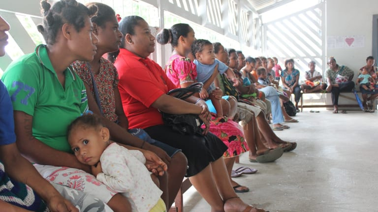 A woman attends a family planning clinic at Port Moresby General Hospital. The weekly clinic is frequently full to capacity, seeing up to 80 women, and offers family planning advice and health screening including pap smears.