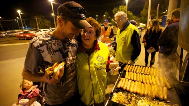 A grateful Shane Buckley shows his appreciation to Rotarian Lyn Marshall.