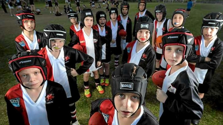 Young players at AJAX Junior Football Club must wear helmets and mouthguards.