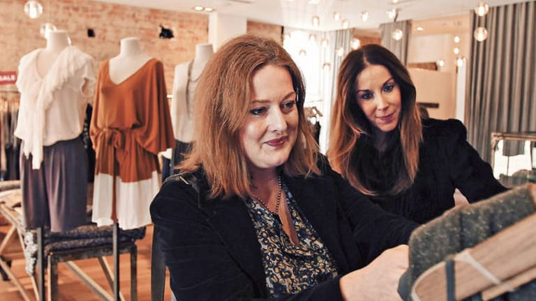 Let's go shopping … Stephanie Wood (at left) and fashionista Penny Hunt begin their search through Sydney boutiques.